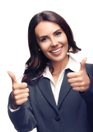 Portrait of happy smiling beautiful businesswoman showing thumbs up gesture, in grey confident suit, isolated over white background