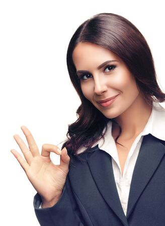 Happy smiling beautiful young businesswoman in grey confident suit, showing okay gesture, isolated against white background