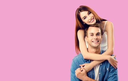 Love, relationship, dating, flirting, lovers, romantic concept - lovely couple, standing close to each other, over rose pink background. Copy space for some text. 스톡 콘텐츠