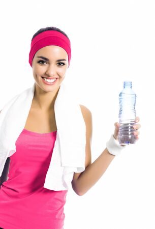 Happy smiling girl in red fitness wear with bottle of water, isolated over white background Stok Fotoğraf