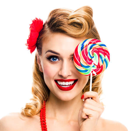 Half face portrait of excited woman with lollipop covering one eye. Pin up girl with happy smile. Retro style image. Isolated over white background. Square composition. Ophthalmology concept.