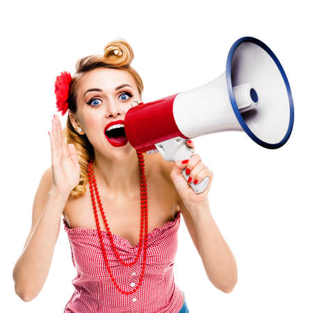 Beautiful woman holding megaphone and shout something. Girl in pin-up style, isolated over white background. Caucasian model with open mouth posing in retro vintage studio concept. Square composition. Archivio Fotografico