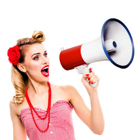 Excited woman holding megaphone and shout something. Girl in pin up style, isolated over white background. Caucasian model with open mouth in retro vintage studio concept. Square composition. 写真素材