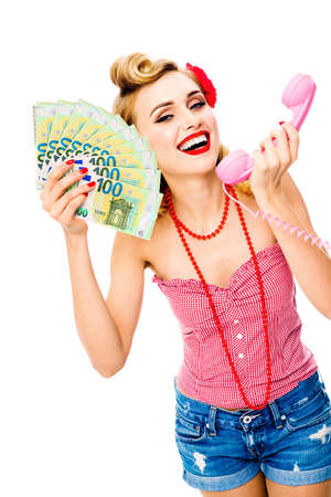 Happy woman with half closed eyes, holding money euro cash banknotes, talking on phone, pin up style. Young girl in retro fashion and vintage studio concept. Isolated over white background. Stock fotó