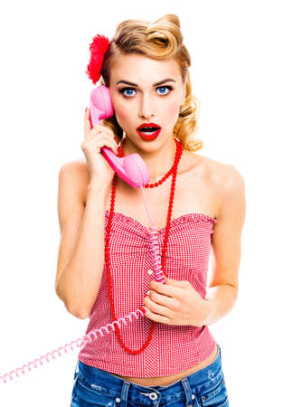 Portrait image - surprised or shocked, amazed blond woman with opened mouth and phone tube. Pin up girl. Retro vintage studio concept. Isolated over white background. Stock fotó