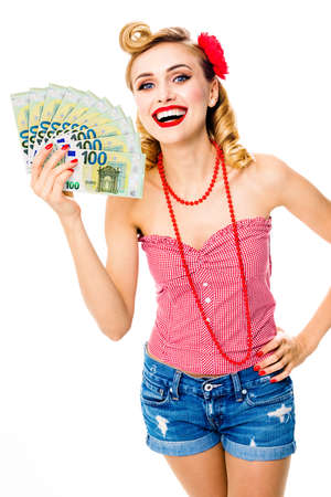Portrait image of very happy, excited pinup beautiful woman holding money euro cash banknotes, pin up style. Blond girl in retro and vintage studio concept. Isolated over white background. Stock fotó