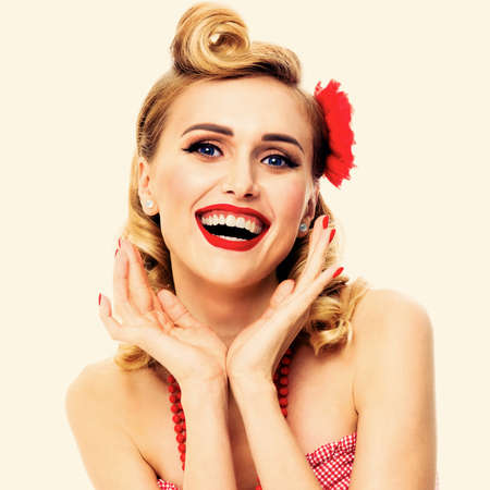 Excited surprised, very happy beautiful woman. Pin up girl with open mouth and raised hands showing cheerful toothy smile. Retro and vintage concept picture. Square composition.