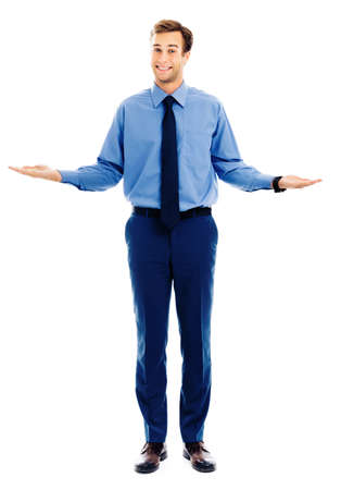 Comparison concept - businessman showing, holding or giving something on both flat hands for similar choice, isolated over white background. Copy space for some text. Full body man in blue clothing. 版權商用圖片