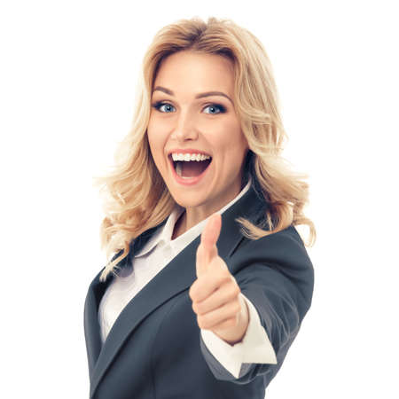 Happy smiling businesswoman in grey confident suit, showing thumbs up gesture, isolated against white background. Caucasian blond model in business success concept. Square composition image.