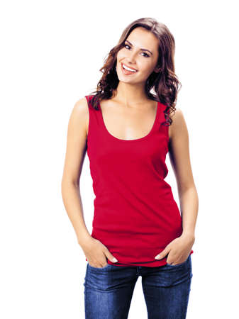 Portrait photo - smiling woman in red color casual smart clothing, blue jeans, isolated over white background. Happy girl in t-shirt at studio. Brunette Model posing at studio picture.