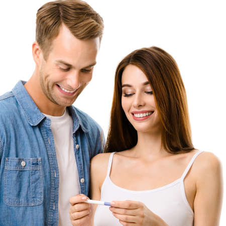 Portrait of smiling amorous couple, finding out results of a pregnancy test. Caucasian models - in love, relationship, dating, happy lovers, family concept, isolated over white background. Square.