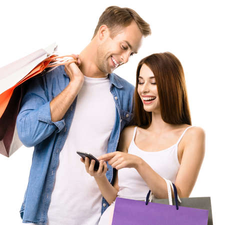 Happy smiling couple with shopping bags, and phone, standing close to each other. Love, holiday sales, shop, retail, discounts, consumer concept, isolated on white background. Square. Standard-Bild