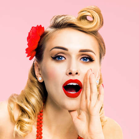 Square image of woman holding hand near open mouth and saying something. Girl dressed in pin up style. Blond haired model at retro fashion vintage concept, isolated over rose pink.