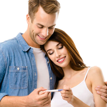Image of young smiling couple, finding out results of a pregnancy test. Man and woman - love, relationship, dating, happy lovers, family concept, isolated over white background. Square.