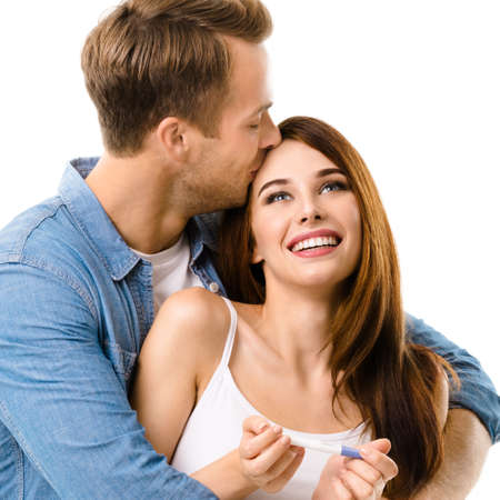 Young couple, finding out results of a pregnancy test. Caucasian models - in love, relationship, dating, happy lovers, family concept, cut out on white background. Square. Standard-Bild