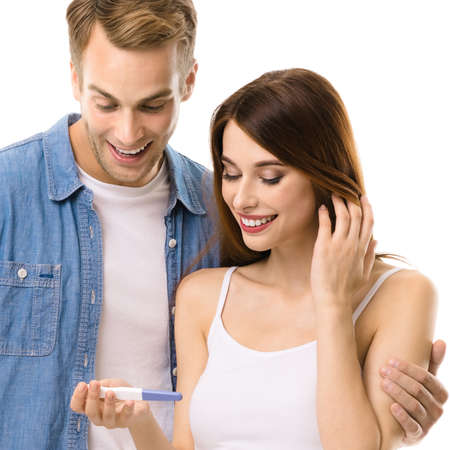 Young couple, finding out results of a pregnancy test. Love, relationship, dating, happy lovers, family concept, isolate over white background. Square.