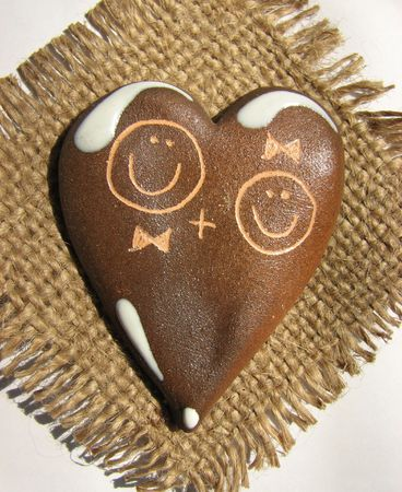 fireclay: Clay heart with faces of boy and girl graven on its surface
