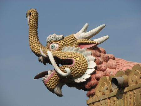 dharma: Dragon statues on the roofs of  buddhistic temples symbolize Dharma protectors