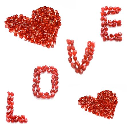 red pomegranate letters and hearts photo