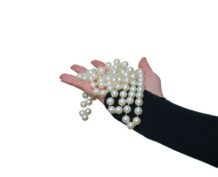 pearls in the womans hand photo