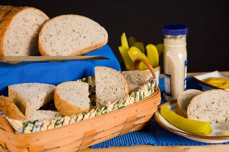 Still life of sliced rye bread with condiments. photo