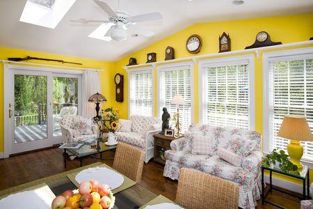 pleasent: Elegant sun room with dinning table, skylights, windows, clocks and rifle