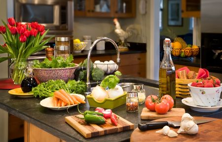 soapstone: A variety of healthy ingredients laid out on kitchen island. Stock Photo