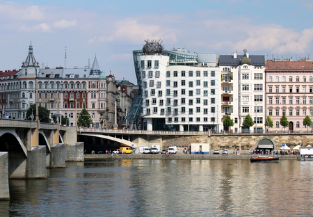 dancing house: Dancing house on embankment at river Vltava in Prague Stock Photo