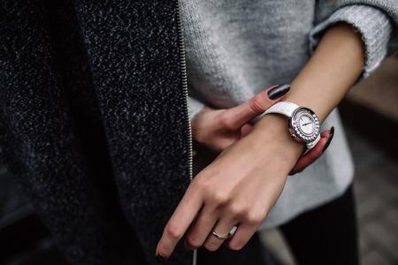 white womens wrist watch on the girls hand