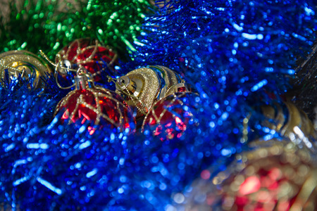 New Year and Christmas toys, in the tinsel on the table Christmas mood, decorations for fur-tree, close up