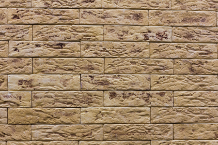 Beige background siding, stone texture tiles, backdrop