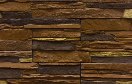 Background brown stones for siding tiles texture, with a relief structure Stock Photo