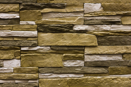 beige natural stone facade, wall tiles texture, background