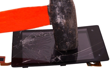 hammer blow on the display of the mobile phone, cracked on the touchscreen. hammer a high-tech device