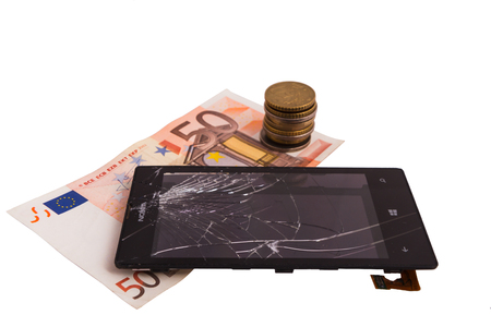 broken display with cracked display and money, euro notes and coins. concept repair fee in the service