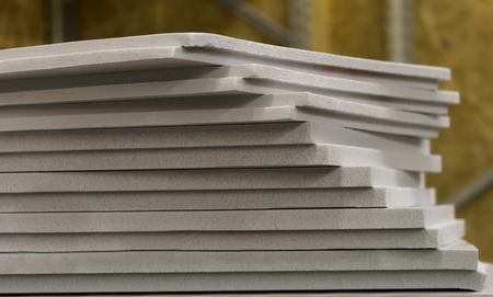 polystyrene slabs lie a tower close-up of gray color. heat insulation for home