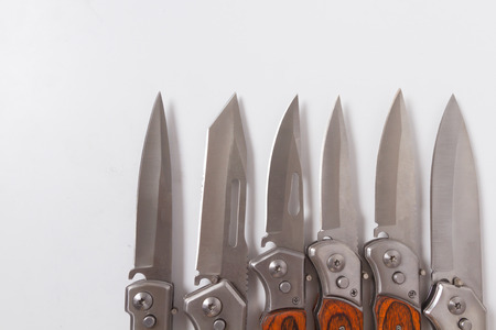 folding blade knife line several lie. Hunting or marching sharp knife and part of the handle.