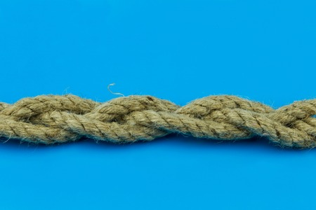 coconut rope binding of three pieces on a blue background is horizontal