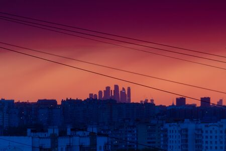Sunset over the city from a high point. Contrast of blue and orange.