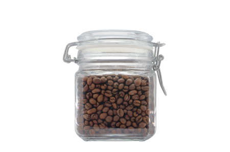 A glass jar filled with coffee beans and closed with a clip-on lid. Isolated on light gray background.