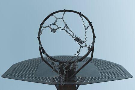 Metallic basketball hoop, basket against blue sky. Outdoor basketball court. Sky board.