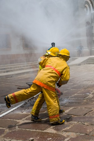 FIREFIGHTERS PUTTING OUT THE FIRE