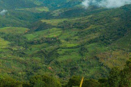COLOMBIAN MOUNTAIN LANDSCAPE AT SUNRISE WITH NICE CLOUDS AND COFFEE CROPS IN THE BACKGROUND Imagens