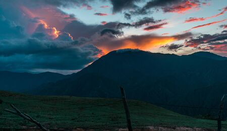 BEAUTIFUL AND RELAXING SUNSET WITH ORANGE SKY OVER THE MOUNTAINS OF COLOMBIA Reklamní fotografie