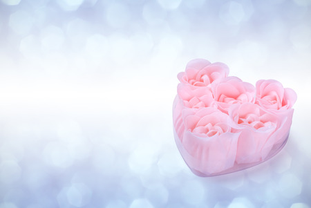 Rose rose natural soap heart on a white background with place for your text photo