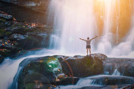 waterfall river: Man on a Great waterfall in a Carpathian mountains. Ukraine