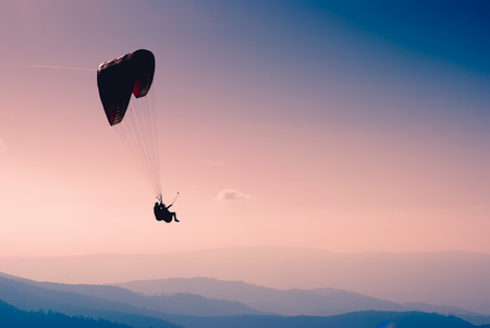 Paraglide in a sky above Carpathian mountains 版權商用圖片