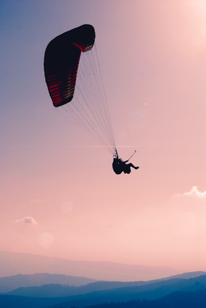 paraglide: Paraglide in a sky above Carpathian mountains Stock Photo
