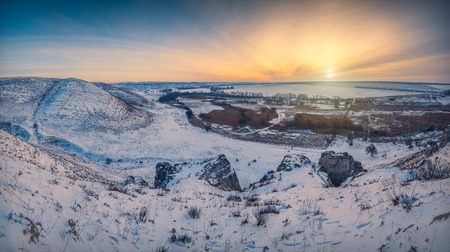 Beautiful sunrise in a winter snow valley photo