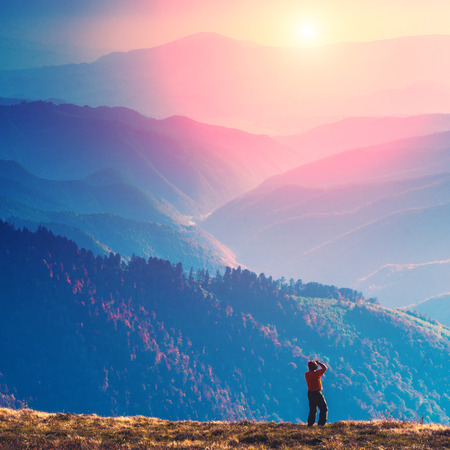 Photographer stay on a hill and shut mountain landscapes Stock Photo